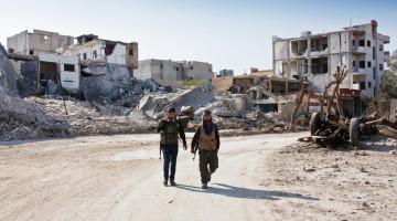 Курдські вояки прямують до своїх укріплень в Кобані, Сирія